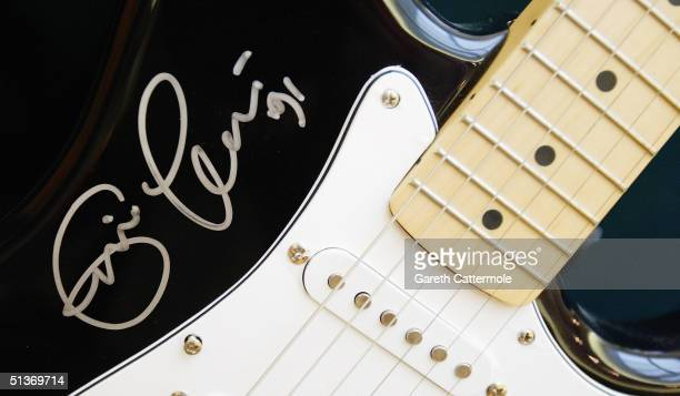 A guitar signed by Eric Clapton is seen ahead of the 'Pop Memorabilia' auction at Christie's South Kensington on September 29 2004 in London The...