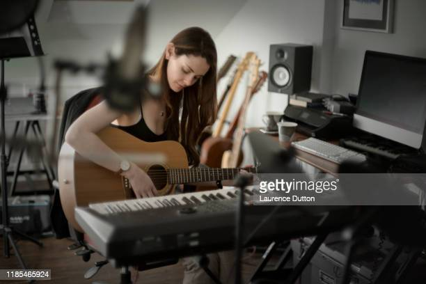 guitar studio woman - songwriter stock pictures, royalty-free photos & images