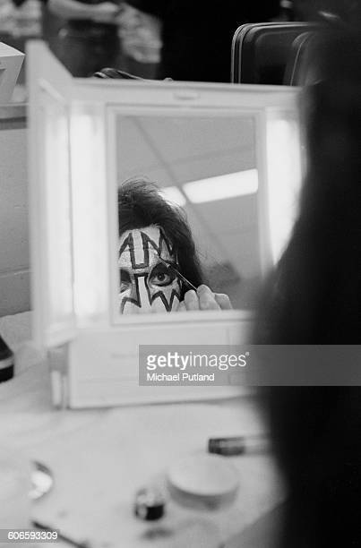 Guitarist Ace Frehley of American heavy metal group Kiss applying makeup backstage during the band's Rock Roll Over tour New York February 1977