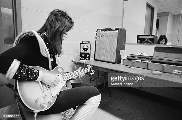 Guitarist Ace Frehley of American heavy metal group Kiss practising backstage during the band's Rock Roll Over tour New York February 1977