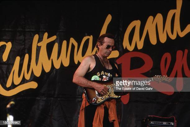 Guitarist and composer Ry Cooder performs at the New Orleans Jazz and Heritage Festival in April 1994 in New Orleans Louisiana