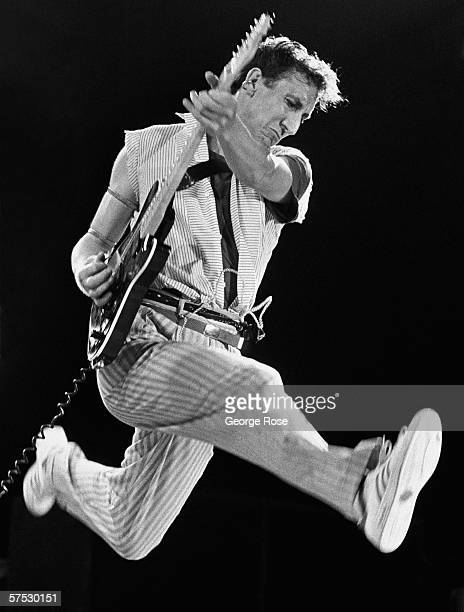 Guitarist and creative genius behind The Who, Pete Townshend, performs his signature leap during one of the legendary rock band's final 1982 concerts...