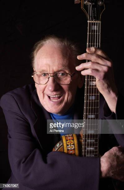 Guitarist and inventor Les Paul poses for a portrait with the guitar that he invented in circa 2000 in New York City New York