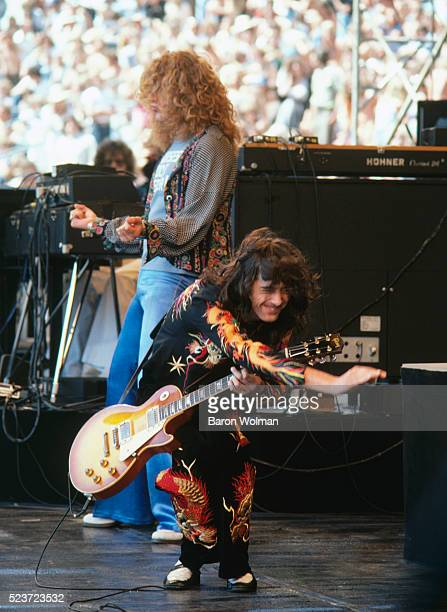 Guitarist and leader of English rock band Led Zeppelin Jimmy Page performs at the Day on the Green Oakland Coliseum Oakland California July 1977