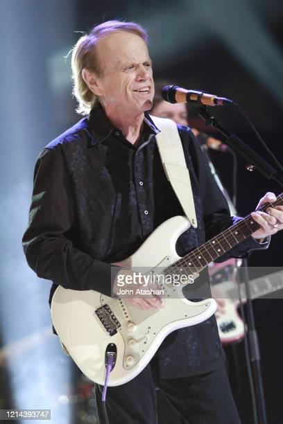 Guitarist and singer Al Jardine is shown performing on stage during a live concert appearance with The Beach Boys during their 50th Anniversary...