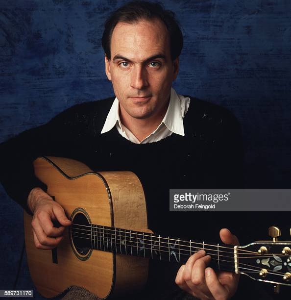 Guitarist and singer James Taylor posing in his apartment in January 1986 in New York City New York