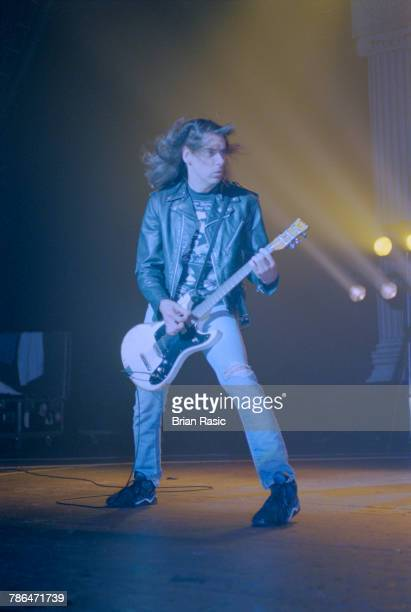 Guitarist and songwriter Johnny Ramone performs live on stage playing a Mosrite guitar with American punk group Ramones at Brixton Academy in London...