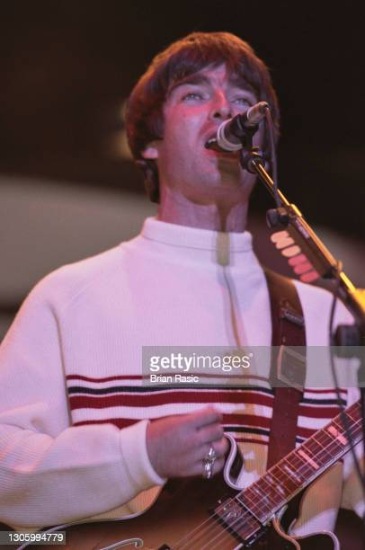 Guitarist and songwriter, Noel Gallagher, performing with British rock group, Oasis, at Knebworth House, Hertfordshire, 10th August 1996.