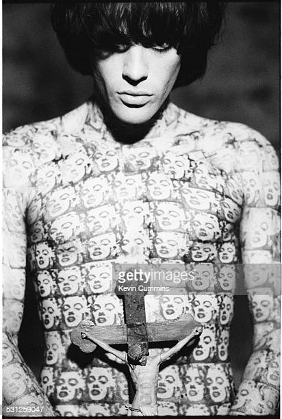 Guitarist and songwriter Richey James Edwards of Welsh rock group Manic Street Preachers 23rd September 1992 He is holding a crucifix and wearing a...