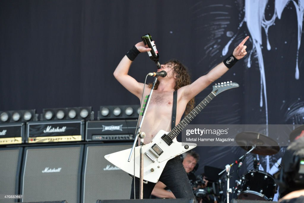 Guitarist and vocalist Joel O'Keeffe of Australian hard rock group Airbourne performing live on the Zippo Encore Stage at Download Festival on June 16, 2013.