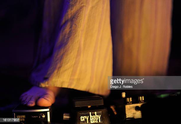 Guitarist and vocalist of rock band Yamn Brian Hamilton hits his pedals barefoot during a show in Three 20 South club in Breckenridge on Saturday...