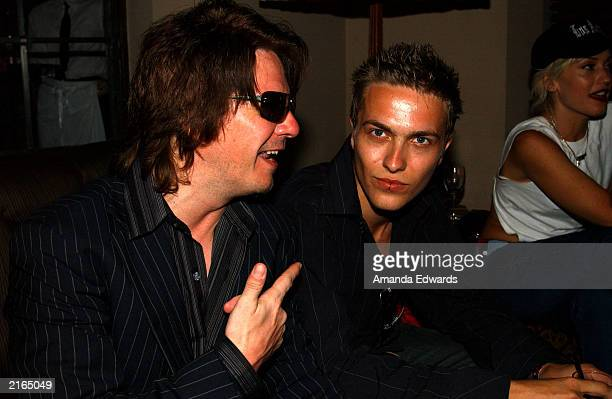 Guitarist Andy Taylor and his son Andy Jr pose at an afterparty at the Chateau Marmont on July 15 2003 in Hollywood California The party followed a...