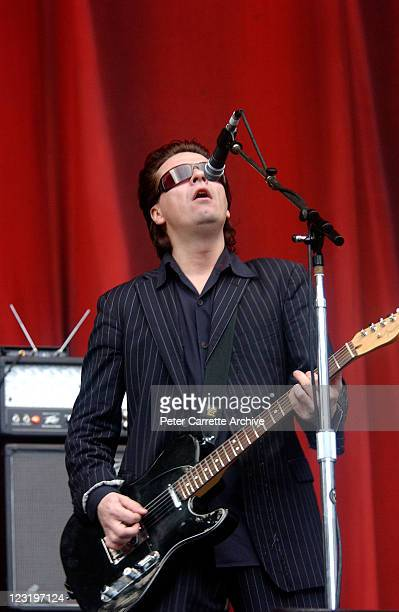 Guitarist Andy Taylor from the band Duran Duran performing on stage during their concert at Aussie Stadium on December 13 2003 in Sydney Australia