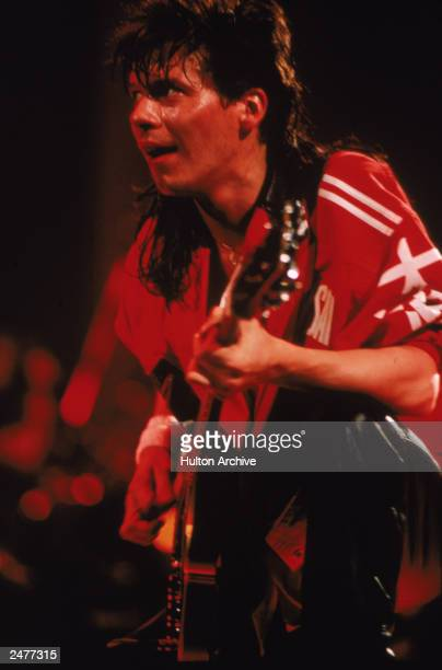 Guitarist Andy Taylor of the British pop group Duran Duran performing on stage during a concert 1984