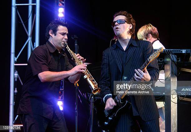 Guitarist Andy Taylor performing on stage with the band Duran Duran during their concert at Aussie Stadium on December 13 2003 in Sydney Australia