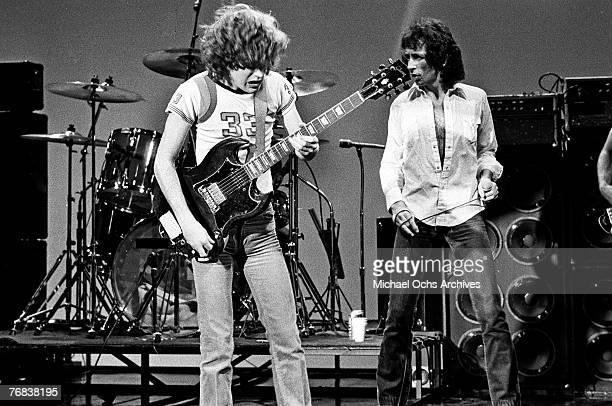 Guitarist Angus Young and singer Bon Scott rehearse for a gig circa 1977 in Hollywood California