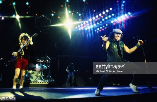 Guitarist Angus Young drummer Simon Wright rhythm guitarist Malcolm Young and singer Brian Johnson of AC/DC put on an energetic show on October 18 at...
