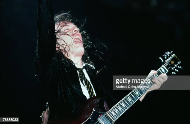 Guitarist Angus Young of AC/DC hits a chord during a concert on October 18 at the Forum in Inglewood California