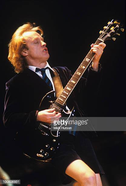 Guitarist Angus Young of AC/DC performs on stage at Wembley Arena in London England on December 04 2000