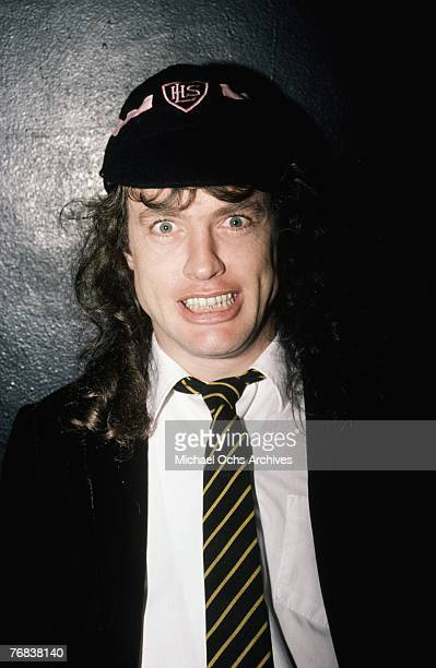 Guitarist Angus Young of AC/DC poses for a photo backstage before a show at the Forum on October 18 in Inglewood California