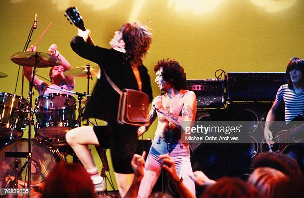 Guitarist Angus Young of AC/DC shows his trademark energy on stage while drummer Phil Rudd singer Bon Scott and bassist Mark Evans provide suport...