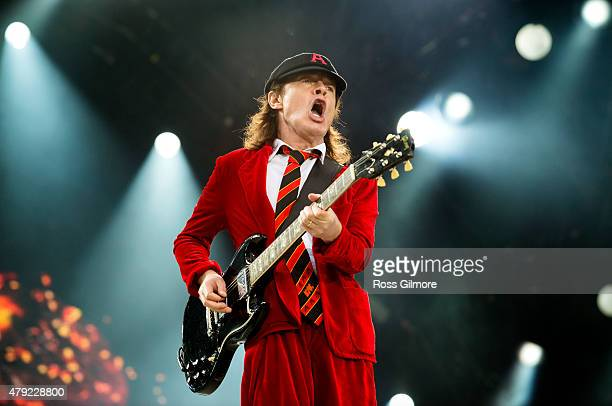 Guitarist Angus Young of the Australian band AC/DC performs at at Hampden Park National Stadium on June 28 2015 in Glasgow United Kingdom