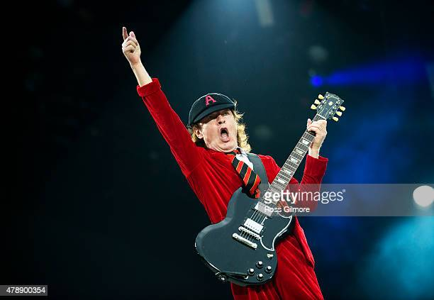 Guitarist Angus Young of the Australian band AC/DC performs at Hampden Park National Stadium on June 28 2015 in Glasgow United Kingdom