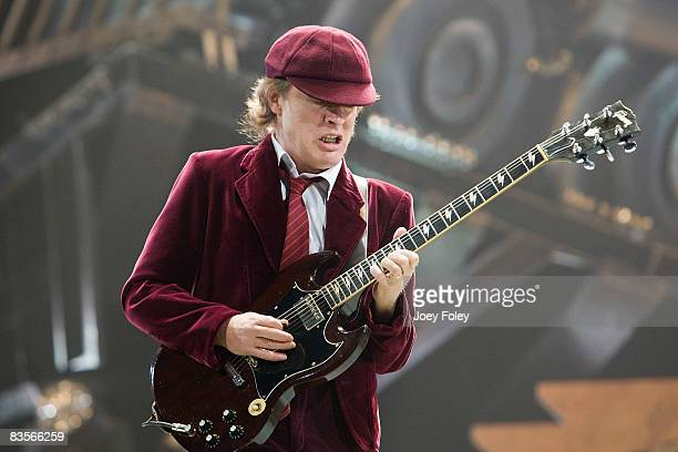 Guitarist Angus Young of the Australian rock band AC/DC performs in concert on just the four stop of their 'Black Ice World Tour' at the Conseco...