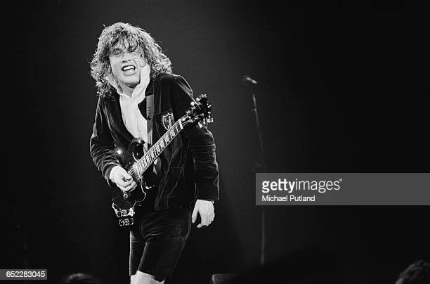 Guitarist Angus Young performing with Australian hard rock group AC/DC November 1980