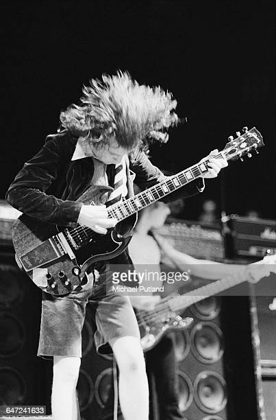 Guitarist Angus Young performing with Australian heavy rock group AC/DC in New York August 1979