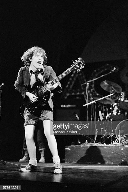 Guitarist Angus Young performing with hard rock group AC/DC at the Lyceum London 8th July 1976