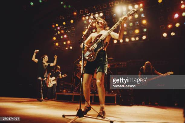 Guitarist Angus Young performing with heavy rock group AC/DC London 1980 Left to right Brian Johnson Malcolm Young Angus Young and Cliff Williams