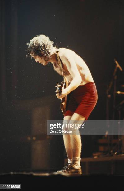 Guitarist Angus Young performing with rock group AC/DC circa 1980
