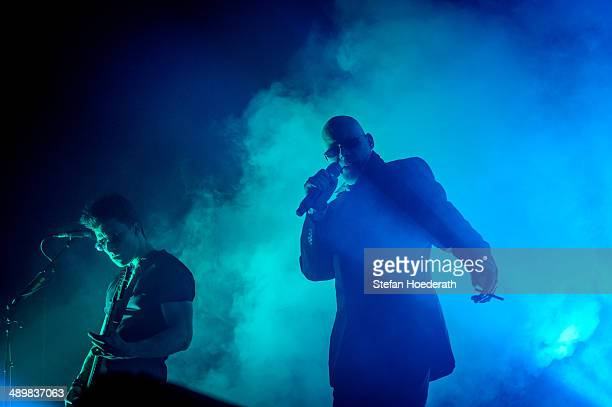 Guitarist Ben Christo and singer Andrew Eldritch of British group The Sisters Of Mercy perform live during a concert at Columbiahalle on May 12 2014...
