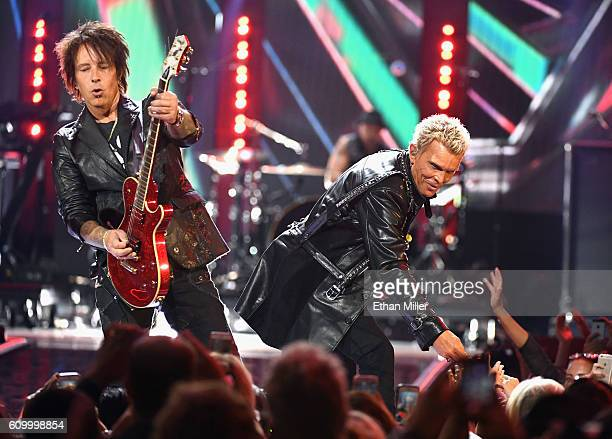 Guitarist Billy Morrison and singer Billy Idol perform onstage at the 2016 iHeartRadio Music Festival at TMobile Arena on September 23 2016 in Las...