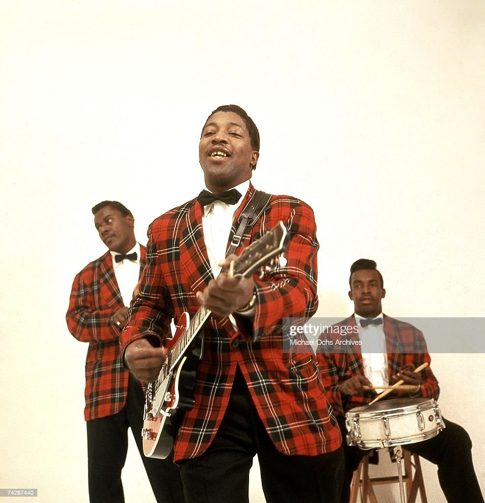 Guitarist Bo Diddley poses for a portrait with his Gretsch electric guitar and Jerome Green on his right playing maracas in circa 1958 in New York City, New York.