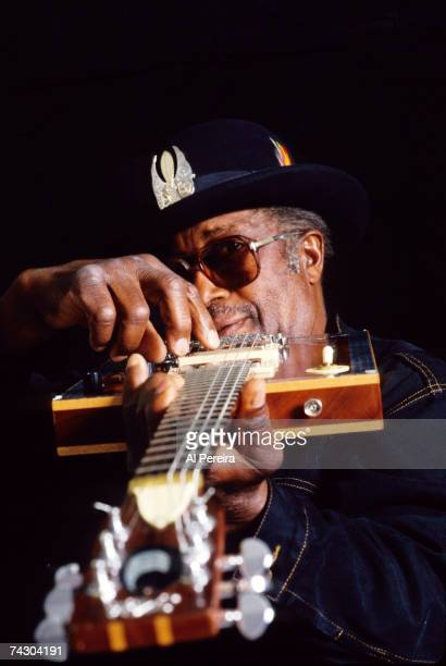 Guitarist Bo Diddley sits for a portrait with his hand up to his mouth in circa 1995 in New York City New York