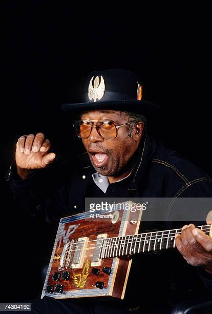 Guitarist Bo Diddley sits for a portrait with his trademark boxshaped Gretsch electric guitar in circa 1995 in New York City New York