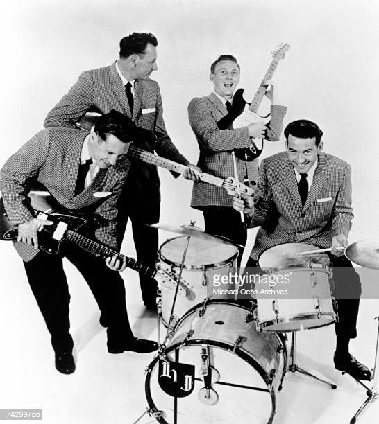 Guitarist Bob Bogle bassist Nokie Edwards guitarist Don Wilson and drummer Howie Johnson of the rock and roll band The Ventures pose for a portrait...