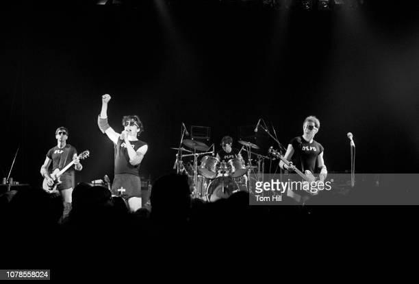 Guitarist Bob Casale singerguitarist Mark Mothersbaugh drummer Alan Myers and bassist Gerald Casale of Devo perform at The Agora Ballroom on December...