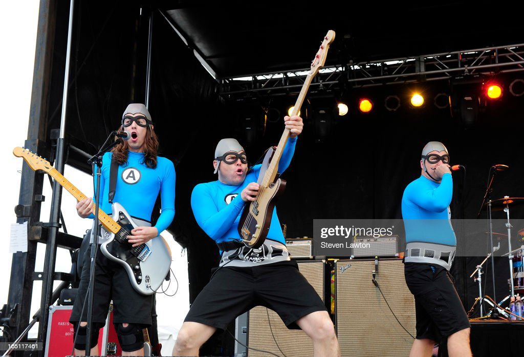 Guitarist Bones, bassist Crash McLarson and MC Bat Commander of the band The Aquabats perform during the 18th annual Extreme Thing Sports & Music Festival on March 30, 2013 in Las Vegas, Nevada.
