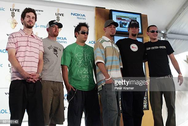 Guitarist Brad Delson bassist Dave 'Phoenix' Farrell DJ Joe Hahn singer Mike Shinoda drummer Rob Bourdon and singer Chester Bennington of Linkin Park...