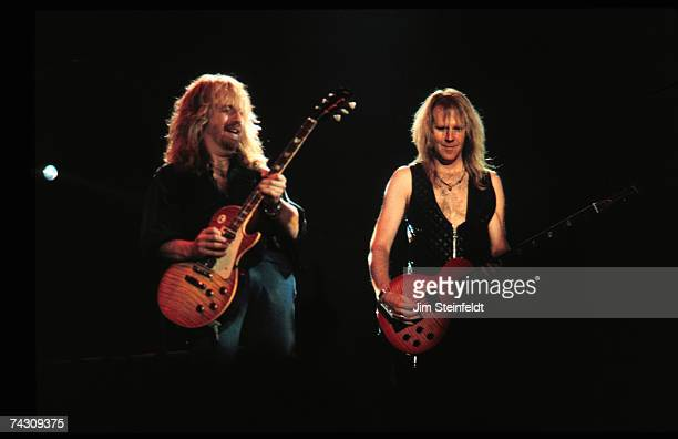 Guitarist Brad Whitford and bassist Tom Hamilton of the rock and roll band Aerosmith perform onstage in 1987 in Minnesota