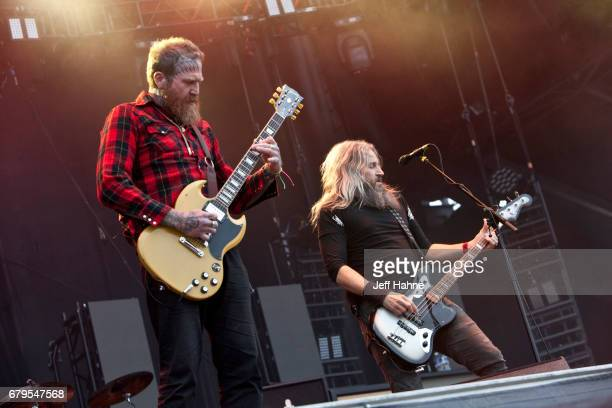 Guitarist Brent Hinds and bassist Troy Sanders of Mastodon perform during Carolina Rebellion at Charlotte Motor Speedway on May 5 2017 in Charlotte...