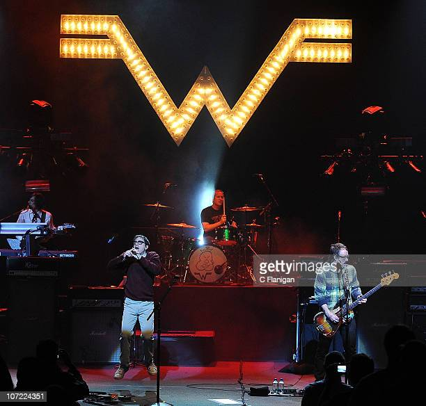 Guitarist Brian Bell, vocalist Rivers Cuomo, drummer Josh Freese and bassist Scott Shriner of Weezer perform during the bands re-release 'Pinkerton'...