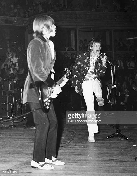 Guitarist Brian Jones and singer Mick Jagger of The Rolling Stones performing live on stage at the Royal Albert Hall London September 25th 1966
