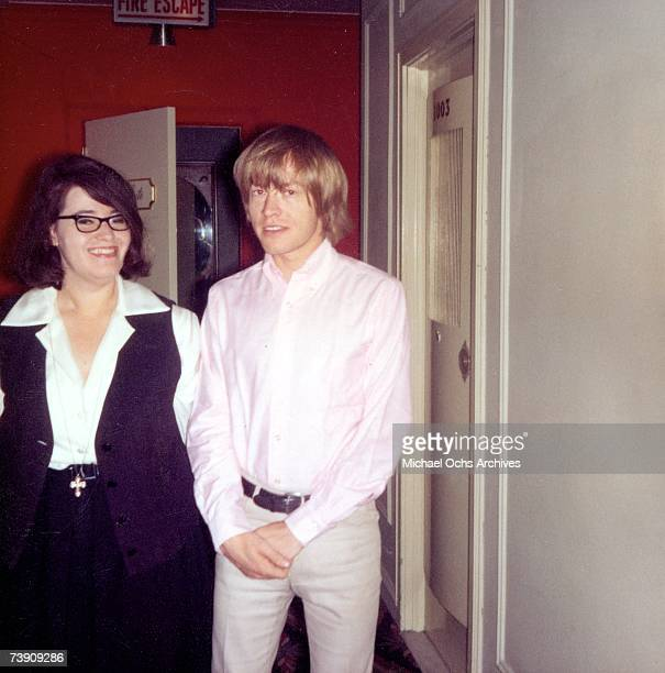 Guitarist Brian Jones of the rock and roll band The Rolling Stones poses for a portrait with Jery Holloway on May 11 1965 in Chicago Illinois