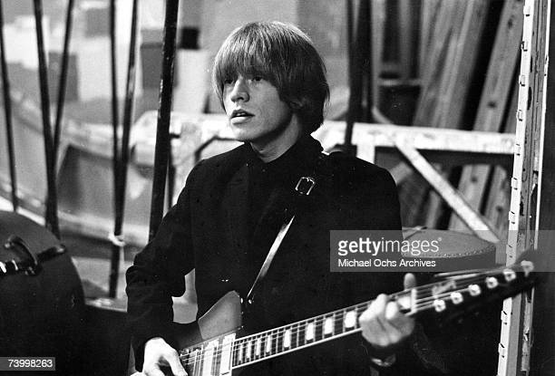 Guitarist Brian Jones of the rock and roll band 'The Rolling Stones' performs onstage in circa 1965