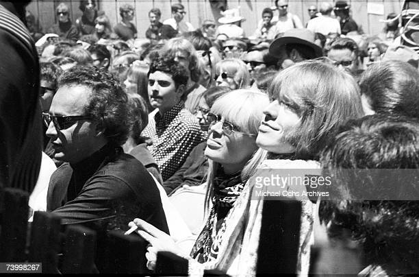 Guitarist Brian Jones of the rock and roll band 'The Rolling Stones' with Christa Paeffgen mills about at the Monterey Pop Festival on June 18 1967...