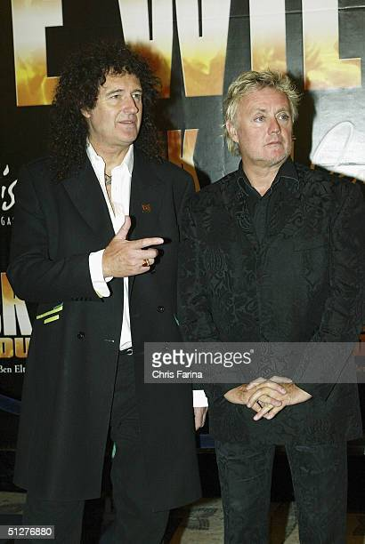 Guitarist Brian May and drummer Roger Taylor founding members of the rock group Queen arrive at the We Will Rock You North American premiere at Paris...